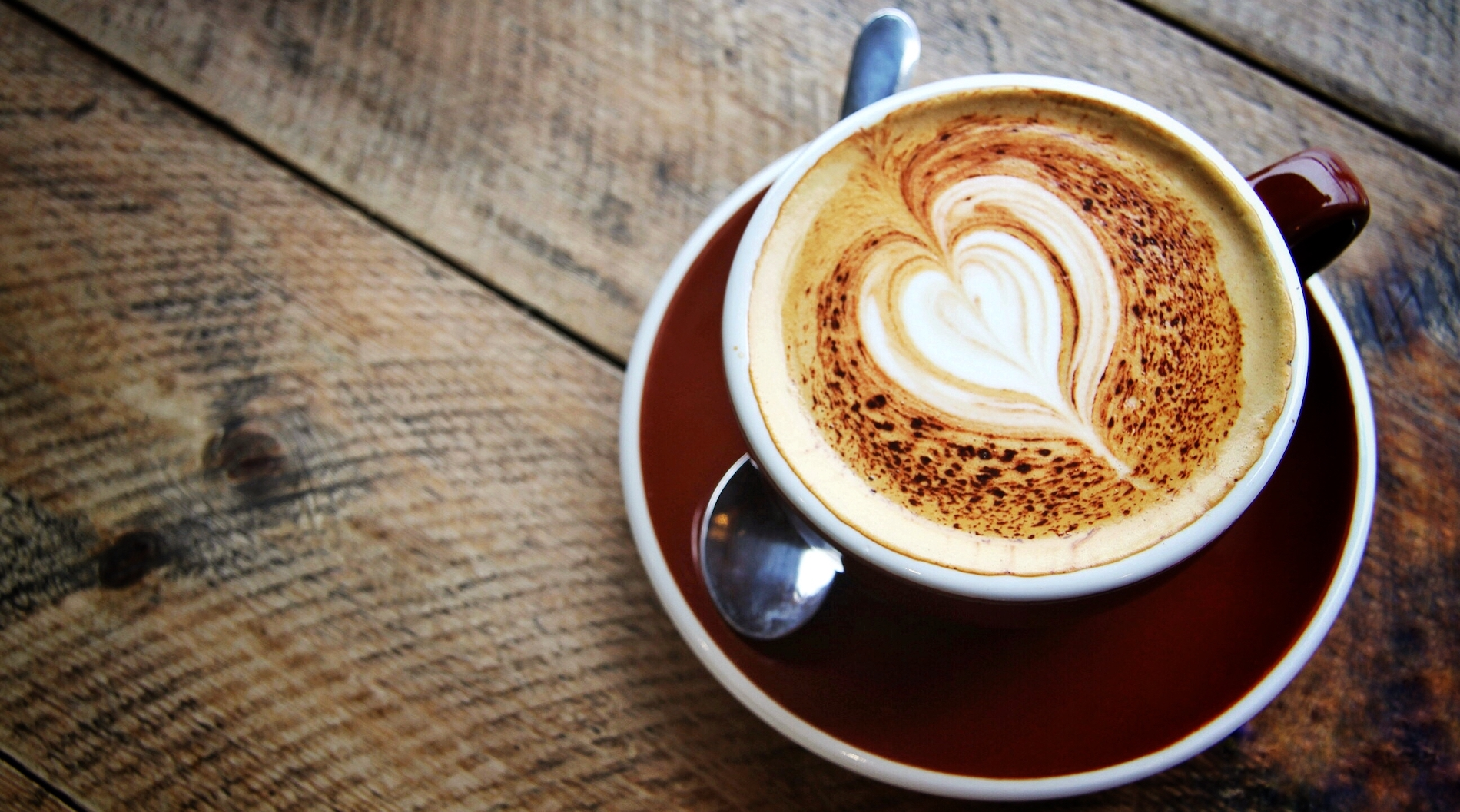 from-above-onto-a-cappucino-coffee-cup-and-saucer–7B3H2YN