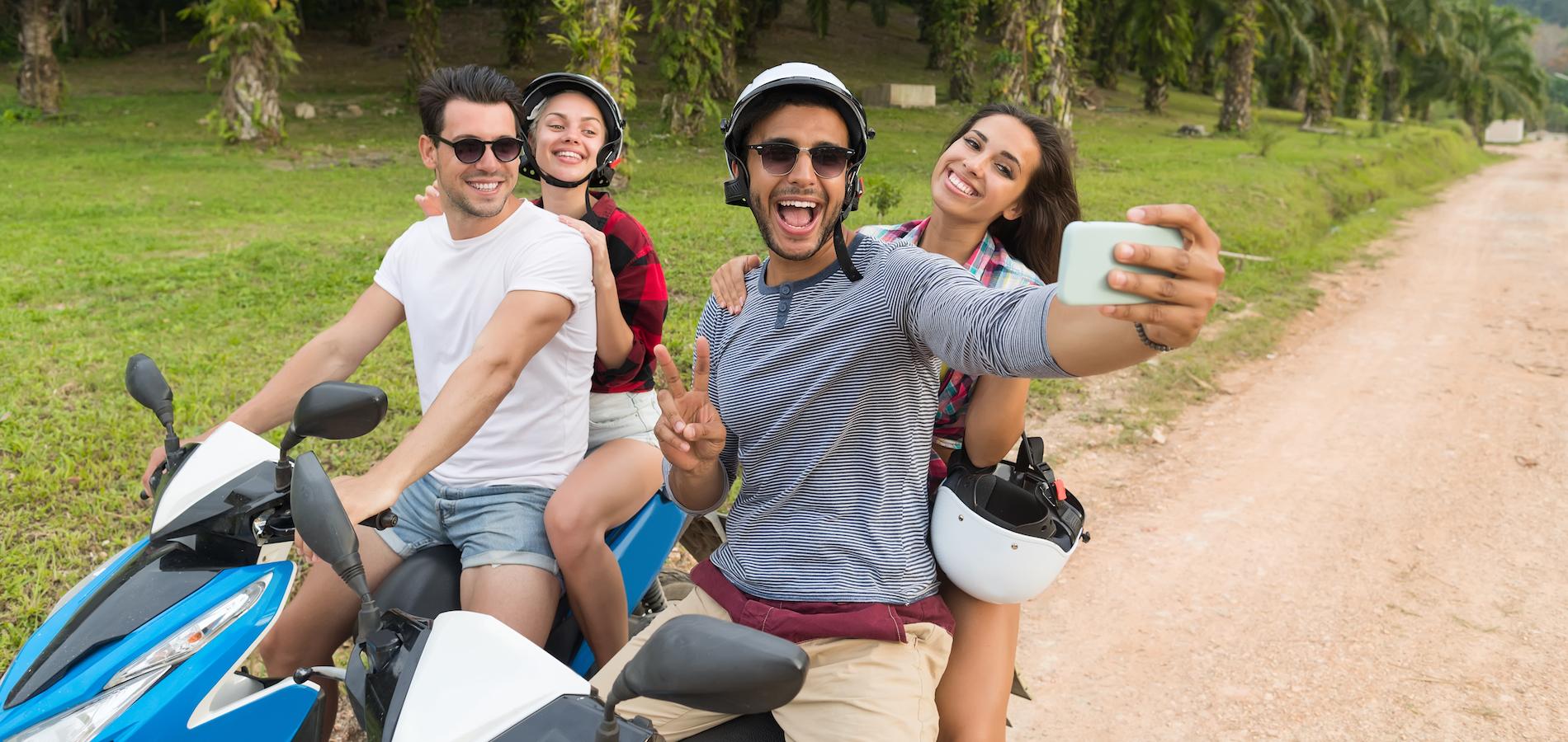 two-couple-riding-motorbike-man-and-woman-taking-2021-04-06-12-02-37-utc